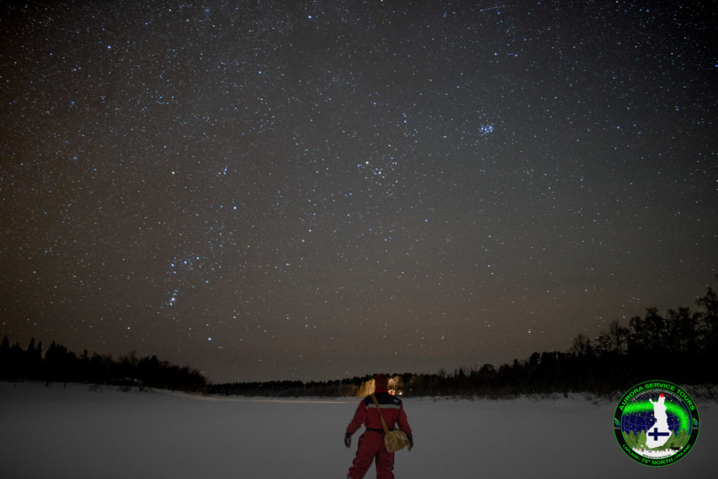 Stood under starry skies on river in Lapland