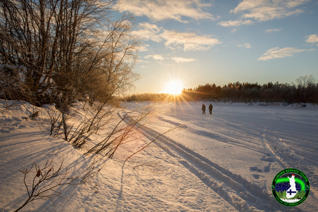 Walks along the frozen river in Lapland